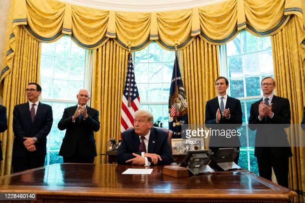US Treasure Secretary Steven Mnuchin US Vice President Mike Pence US President Donald Trump and Advisor Jared Kushner speak in the Oval Office to...