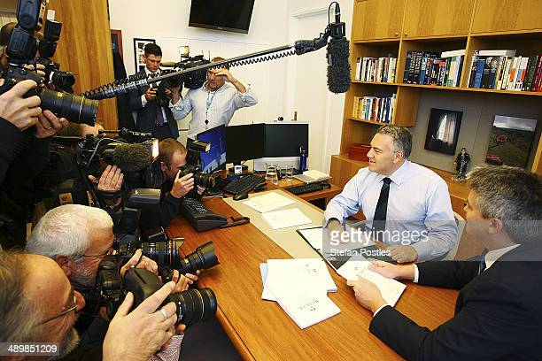 Treasurer Joe Hockey and Finance Minister Mathias Cormann look over the Federal Budget in the Treasurers office at Parliament House on May 13 2014 in...