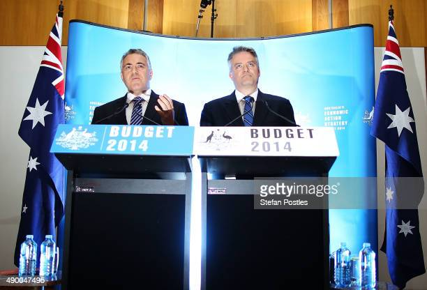 Treasurer Joe Hockey and Finance Minister Mathias Cormann speak to the media during a press conference within the budget lockup at Parliament House...