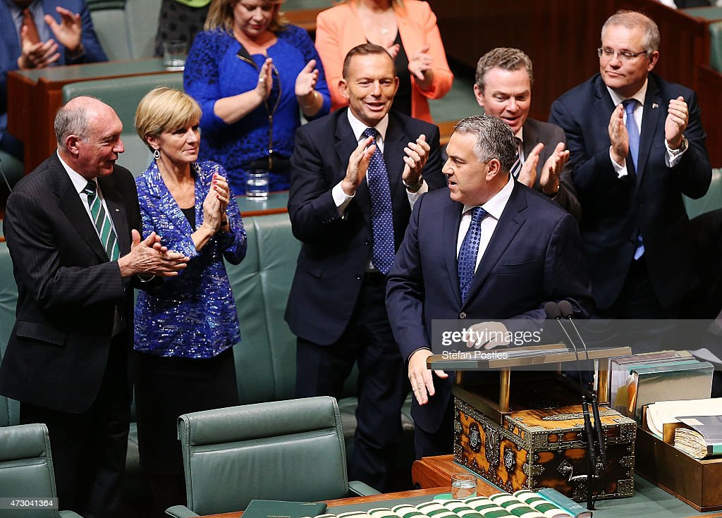 Treasurer Joe Hockey is congratulated after delivering the budget in the House of Representatives in Parliament House on May 12, 2015 in Canberra, Australia. The Coalition governments 2015 federal budget promises to stimulate growth and spending with $5 Billion tax relief for small businesses and a $3.5 Billion reform package for child care.
