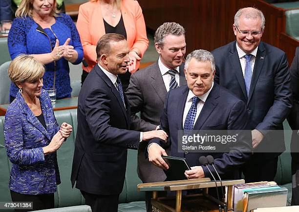 Treasurer Joe Hockey is congratulated after delivering the budget in the House of Representatives in Parliament House on May 12, 2015 in Canberra,...