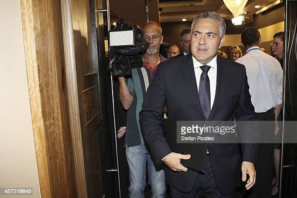 Treasurer Joe Hockey leaves after delivering his midyear budget at National Press Club on December 17 2013 in Canberra Australia The Coalition's...