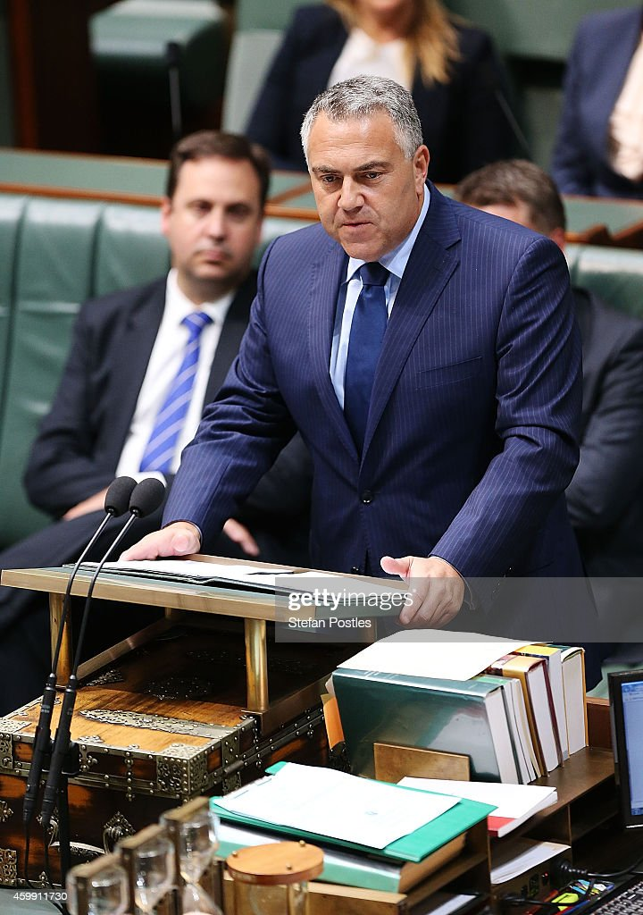 Treasurer Joe Hockey makes a Ministerial Statement in the House of Representatives at Parliament House on December 4, 2014 in Canberra, Australia. Today is the official last day of sitting at Parliament for 2014. Parliament will return on February 9, 2015.