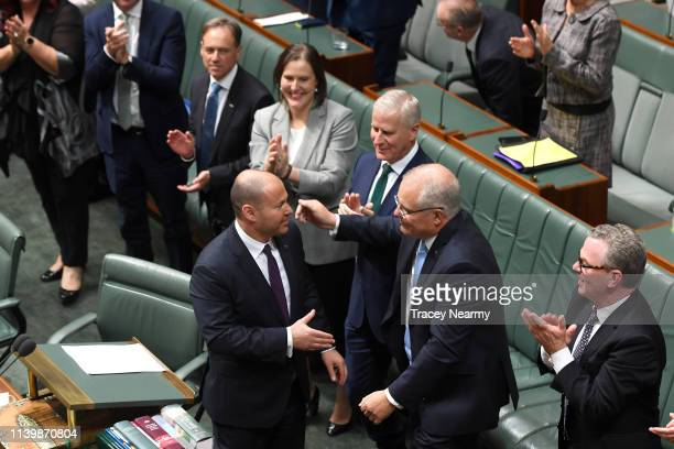 Treasurer Josh Frydenberg is congratulated by Prime Minister of Australia Scott Morrison after delivering the budget in the House of Representatives...