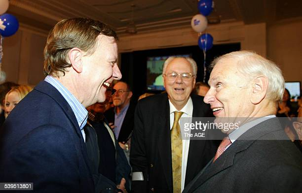 Treasurer Peter Costello with Tony Staley and Richard Alston at Liberal Party Headquarters in Melbourne after the Coalition, 9 October 2004 THE AGE...