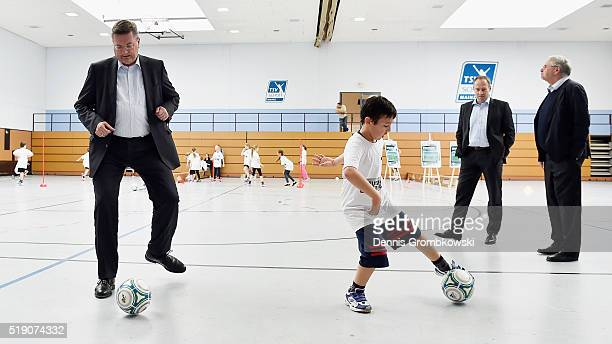DFB treasurer Reinhard Grindel tries the DFB football badge course challenged by a young pupil as German Football Federation DFB launches a new...