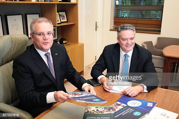 Treasurer Scott Morrison and Minister for Finance Mathias Cormann sit with the 2016 Federal Budget papers in the Treasurers office at Parliament...
