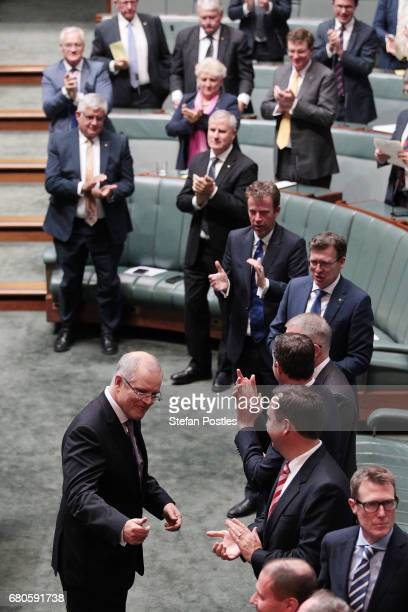 Treasurer Scott Morrison is congratulated by Liberal Party colleagues after delivering the budget in the House of Representatives on May 9 2017 in...