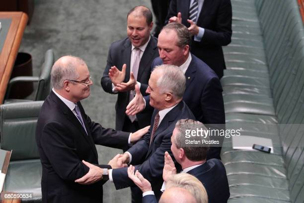 Treasurer Scott Morrison is congratulated by Prime Minister Malcolm Turnbull after delivering the budget in the House of Representatives on May 9...