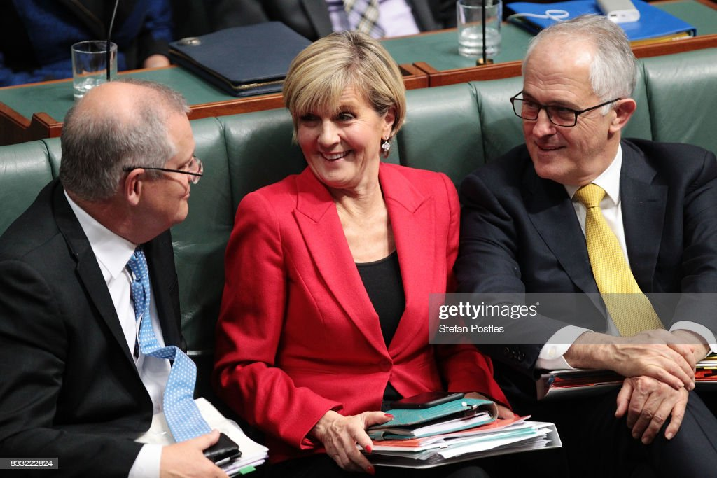 Treasurer Scott Morrison, Minister for Foreign Affairs Julie Bishop and Prime Minister Malcolm Turnbull during House of Representatives question time at Parliament House on August 17, 2017 in Canberra, Australia. Justice Minister is the latest MP to have questions raised over his possible dual citizenship following revelations on Monday that deputy Prime Minister was a dual Australian and New Zealand citizen. Dual citizenship, which is prohibited for members of Parliament under the constitution, has already forced two Greens senators - Scott Ludlum and Larissa Waters - to quit and Nationals senator Matt Canavan to resign as resources minister.