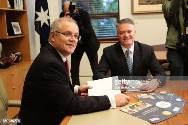 Treasurer Scott Morrison poses in his office with Minister for Finance Mathias Cormann prior to the release of the 2017 Budget on May 9 2017 in...