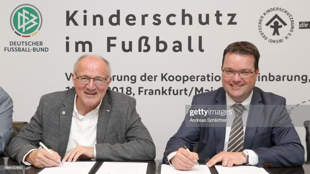 DFB Treasurer Stephan Osnabruegge and Heinz Hilgers sign their contract extension at DFB Headquarter on May 17, 2018 in Frankfurt am Main, Germany.