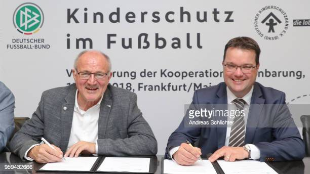 Treasurer Stephan Osnabruegge and Heinz Hilgers sign their contract extension at DFB Headquarter on May 17 2018 in Frankfurt am Main Germany
