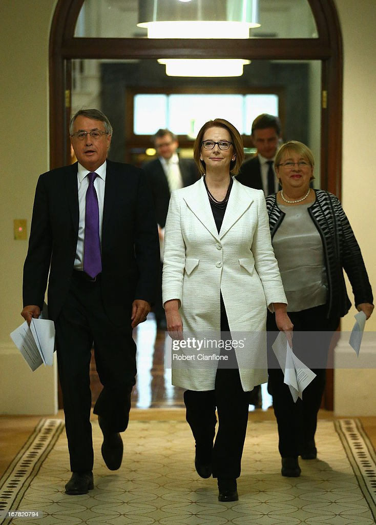 Treasurer Wayne Swan, Australian Prime Minister Julia Gillard and Disability Reform Minister Jenny Macklin arrive for a press conference at the Commonwealth Parliamentary Office on May 1, 2013 in Melbourne, Australia. Gillard has announced that the Federal Government will increase the Medicare levy on income tax from 1.5 to two percent to help fund the National Disability Insurance Scheme (NDIS). The levy will begin on July 1, 2014 and is expected to raise around $3.2 billion annually towards the NDIS which is expected to cost $8 billion per year.
