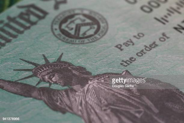us treasury federal tax return check - money politics stock pictures, royalty-free photos & images