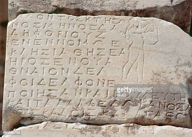 Treasury of the Athenians Temple built around 5th century BC Detail of a hymn to Delphi in ancient Greek engraved in a wall Apollo also appears with...