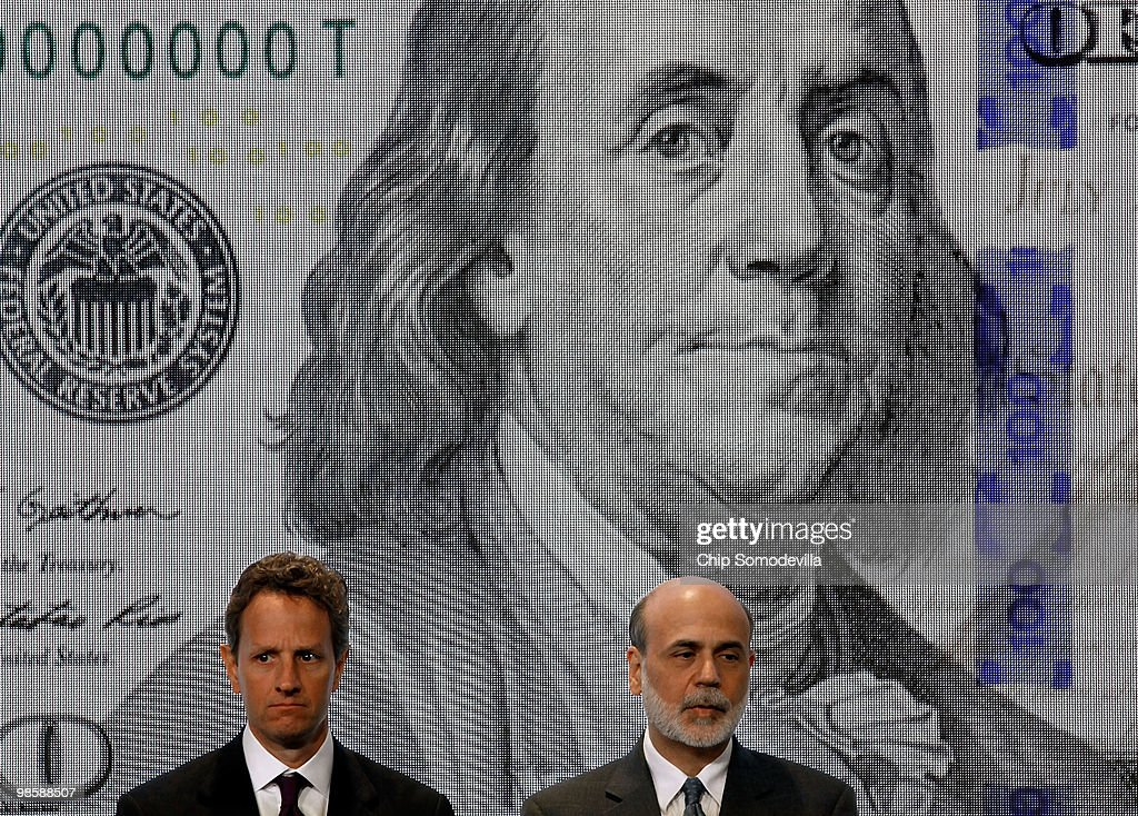 Treasury Secertary Timothy Geithner (L) and Federal Reserve Chairman Ben Bernanke pose for photos during the unveiling of the new $100 note at the Treasury Department April 21, 2010 in Washington, DC. According to the Treasury Department, the U.S. government evaluates advances in digital and printing technology to redesign currency and stay ahead of counterfeiters. The new note will be put into circulation in Feburary 2011.