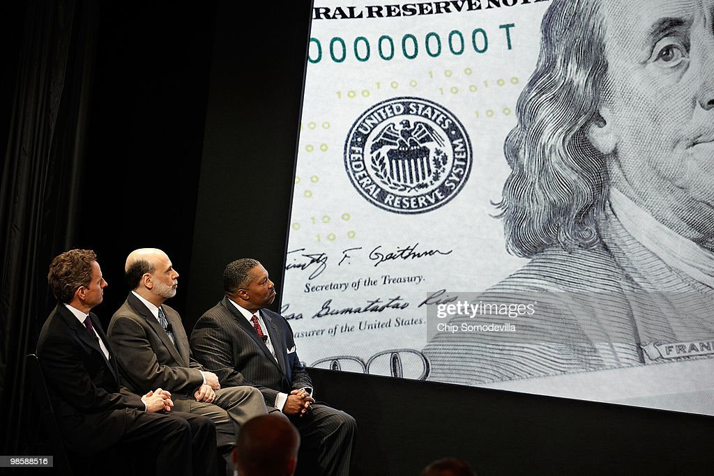 Treasury Secertary Timothy Geithner, Federal Reserve Chairman Ben Bernanke and U.S. Secret Service Deputy Director Keith Prewitt attend the unveiling of the new $100 note at the Treasury Department April 21, 2010 in Washington, DC. According to the Treasury Department, the U.S. government evaluates advances in digital and printing technology to redesign currency and stay ahead of counterfeiters. The new note will be put into circulation in Feburary 2011.