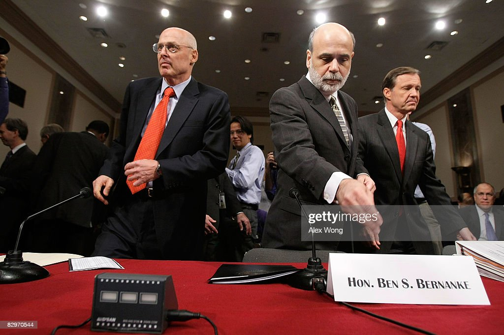 U.S. Treasury Secretary Henry Paulson, Federal Reserve Board Chairman Ben Bernanke, and Chairman of the Securities and Exchange Commission Christopher Cox arrive for a hearing before the Senate Banking, Housing and Urban Affairs Committee September 23, 2008 on Capitol Hill in Washington, DC. The Bush administration officials were testifying about a proposed $700 billion bailout that they hope will stabilize the faltering U.S. financial system. Many members of Congress have expressed anger at the plan they say will pay for Wall Street's mistakes at taxpayers' expense.