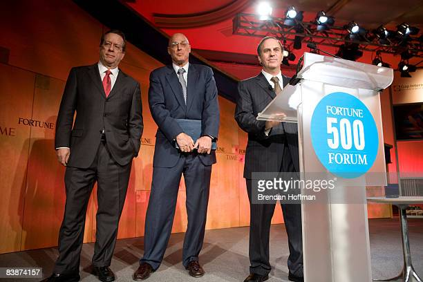 Treasury Secretary Henry Paulson Fortune Magazine Managing Editor Andy Serwer and editorinchief for Time Inc John Huey pose before making remarks at...