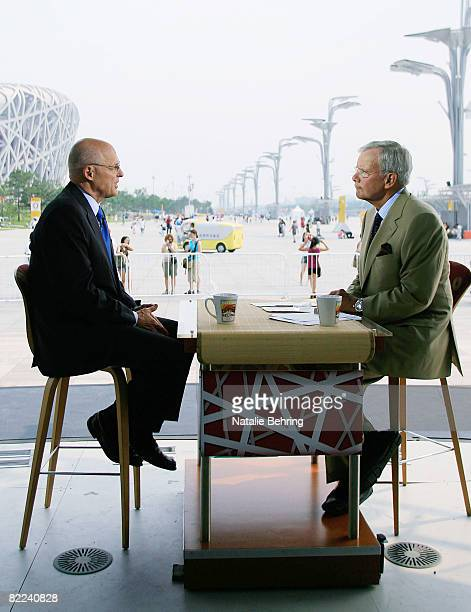 Treasury Secretary Henry Paulson is interviewed by Tom Brokaw for a taping of 'Meet the Press' on the Olympic Green during the Beijing 2008 Olympic...