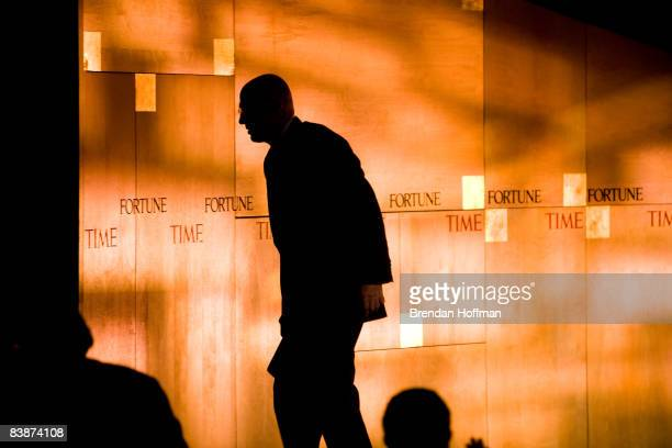 Treasury Secretary Henry Paulson leaves the stage after making remarks at the Fortune 500 Forum at The RitzCarlton Hotel on December 1 2008 in...