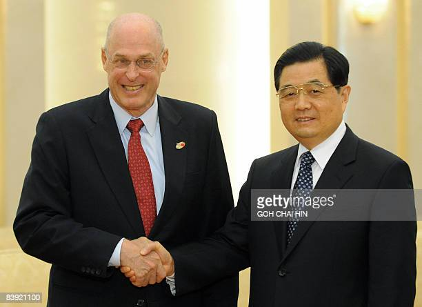 Treasury Secretary Henry Paulson shakes hands with Chinese President Hu Jintao prior to a meeting at the Great Hall of the People in Beijing on...