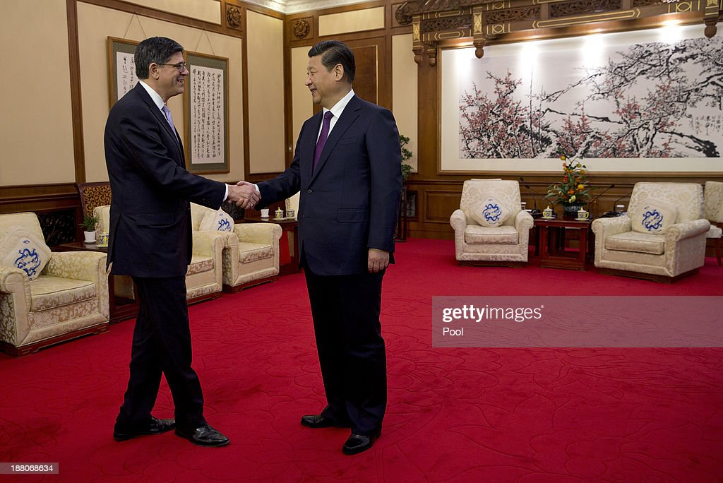 U.S. Treasury Secretary Jack Lew (L) and President Xi Jinping (R) shake hands before their meeting at the Diaoyutai State Guesthouse on November 15, 2013 in Beijing, China.
