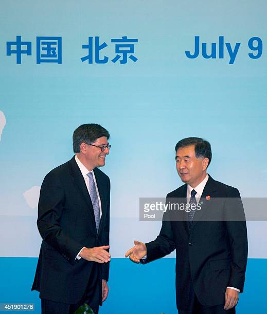 S Treasury Secretary Jack Lew left chats with Chinese Vice Premier Wang Yang as they arrive for the 6th ChinaUS Security Economic Dialogue at the...