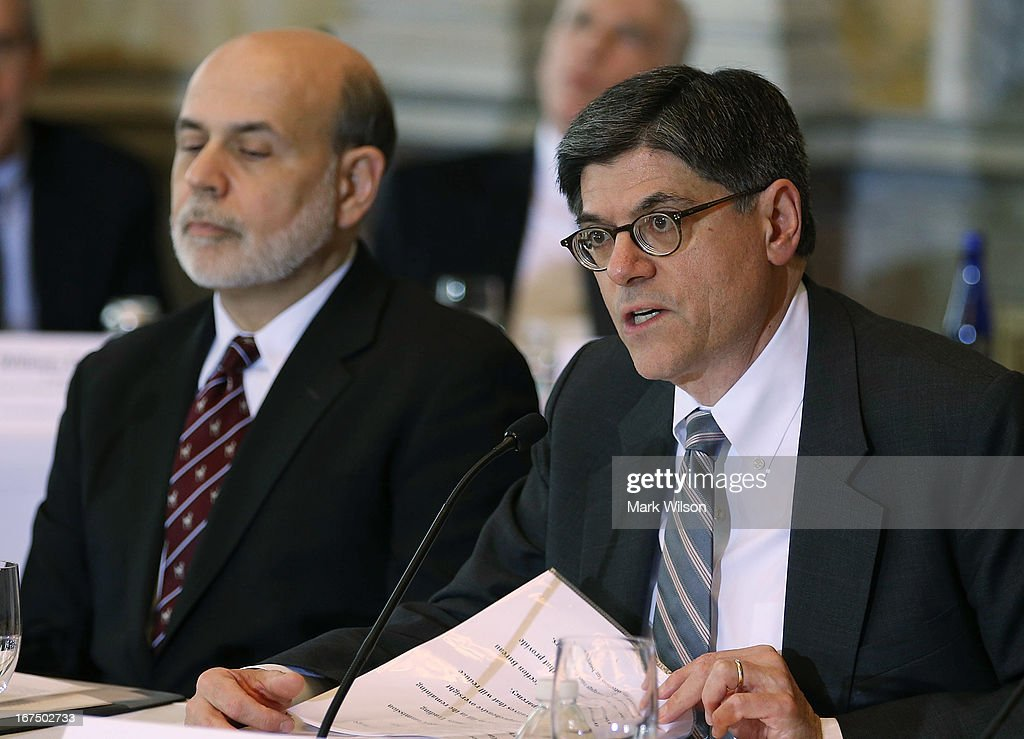 Treasury Secretary Jack Lew (R) speaks while Federal Reserve Chairman Ben Bernanke listens during an open session of the Financial Stability Oversight Council at the Treasury Department, April 25, 2013 in Washington, DC. The session was held to discuss the financial markets and emerging threats to financial stability, and make relevant recommendations.