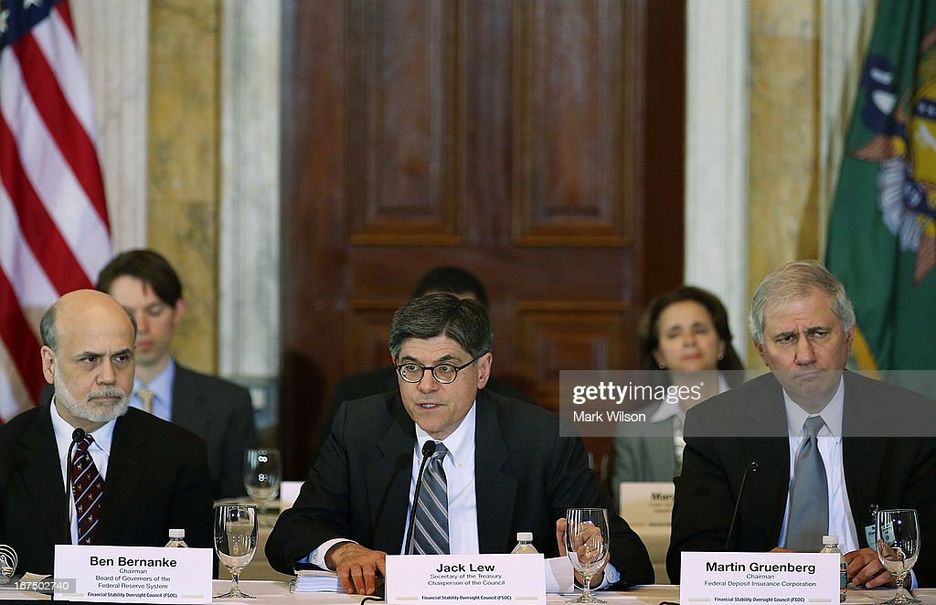 Treasury Secretary Jack Lew (C), speaks while flanked by Federal Reserve Chairman Ben Bernanke (L), and Martin Gruenberg (R), chairman of the Federal Deposit Insurance Corporation, during an open session of the Financial Stability Oversight Council at the Treasury Department, April 25, 2013 in Washington, DC. The session was held to discuss the financial markets and emerging threats to financial stability, and make relevant recommendations.