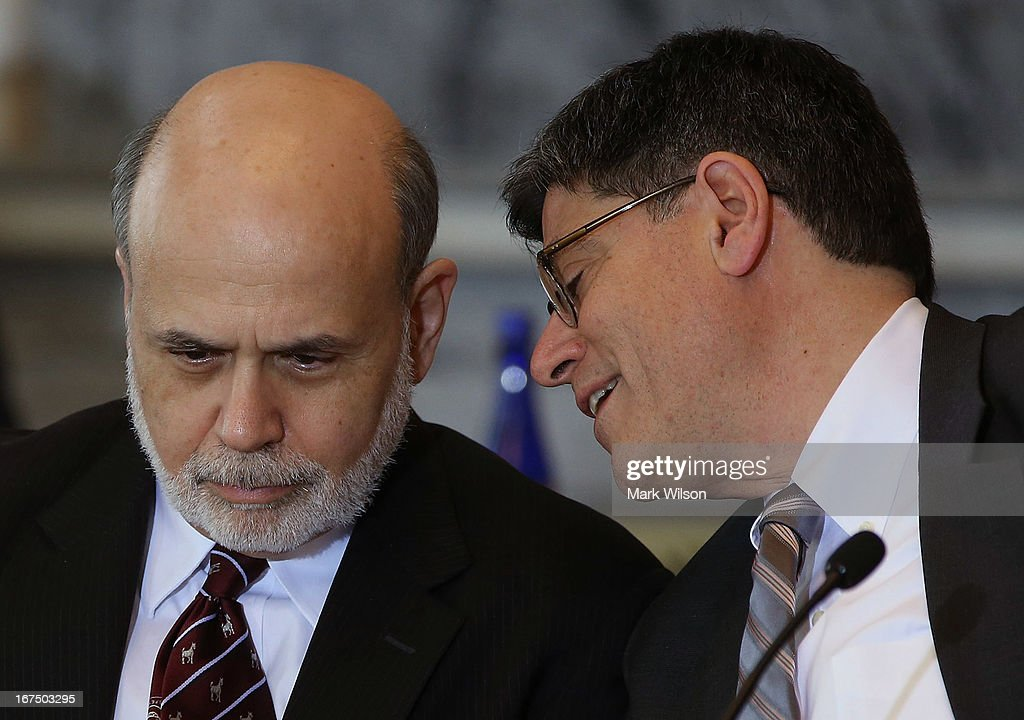 Treasury Secretary Jack Lew (R) speaks with Federal Reserve Chairman Ben Bernanke during an open session of the Financial Stability Oversight Council at the Treasury Department, April 25, 2013 in Washington, DC. The session was held to discuss the financial markets and emerging threats to financial stability, and make relevant recommendations.