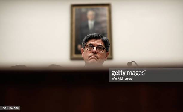 S Treasury Secretary Jack Lew testifies before the House Financial Services Committee on Capitol Hill June 24 2014 in Washington DC Lew testified on...