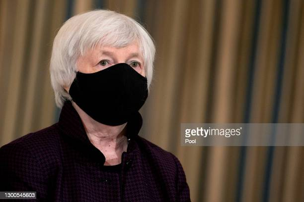 Treasury Secretary Janet Yellen listens to President Joe Biden as he delivers remarks on the national economy and the need for his administration's...