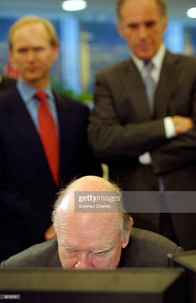U.S. Treasury Secretary John Snow (C) looks closely at a computer screen as JP Morgan Chairman and CEO William Harrison Jr. (R) and Even Berntsen (L), with the JP Morgan foreign exchange desk, watch on the JP Morgan trading floor February 24, 2004 in New York City. Snow said the U.S. economy is performing well and said a team of U.S. Treasury officials is heading to China to address currency exchange rates there.