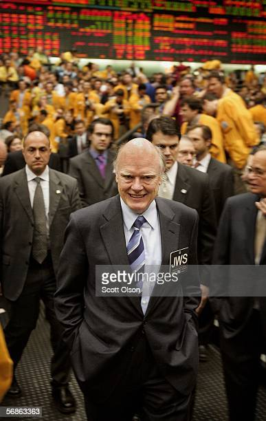 Treasury Secretary John Snow tours a trading floor during a visit to the Chicago Mercantile Exchange February 16 2006 in Chicago Illinois Snow...