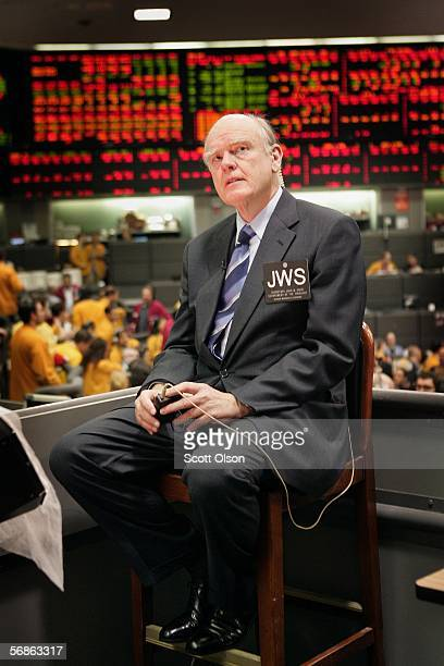 Treasury Secretary John Snow waits for the start of an interview on a riser above the Eurodollar trading floor during a visit to the Chicago...