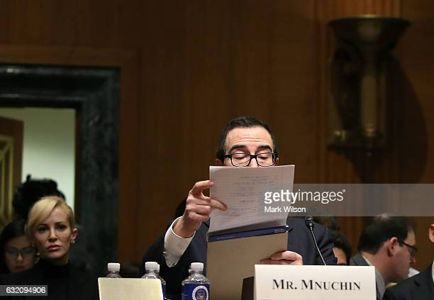 Treasury Secretary nominee Steven Mnuchin looks at his papers during his Senate Finance committee confirmation hearing on Capitol Hill on January 19...