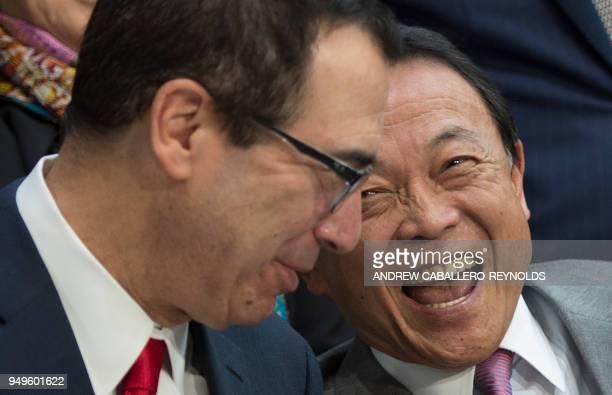 US Treasury Secretary Steve Mnuchin and Japanese Finance Minister Taro Aso talk before the IMFC family photo during the IMF/World Bank spring meeting...