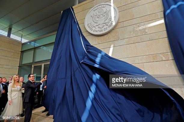 Treasury Secretary Steve Mnuchin and US President's daughter Ivanka Trump unveil an inauguration plaque during the opening of the US embassy in...