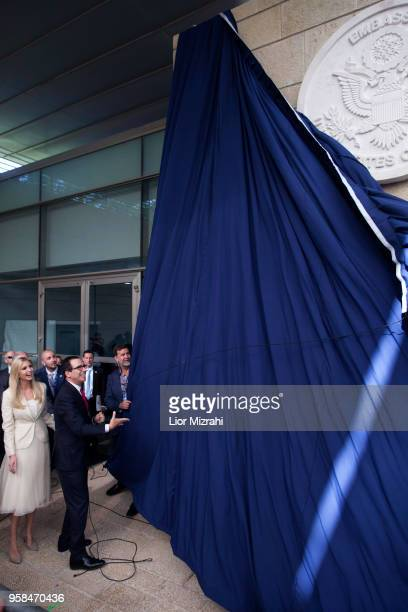 US Treasury Secretary Steve Mnuchin and US President's daughter Ivanka Trump unveil an inauguration plaque during the opening of the US embassy in...