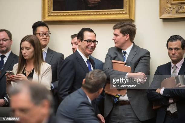 US Treasury Secretary Steve Mnuchin arrives to testify before a House Financial Services Committee hearing on the state of the international...
