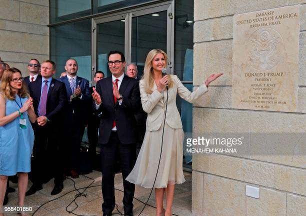 Treasury Secretary Steve Mnuchin claps as US President's daughter Ivanka Trump unveils an inauguration plaque during the opening of the US embassy in...