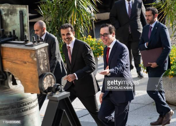 Treasury Secretary Steve Mnuchin greets the emir of Qatar Sheikh Tamim bin Hamad al-Thani at the Treasury Department for a dinner with US President...