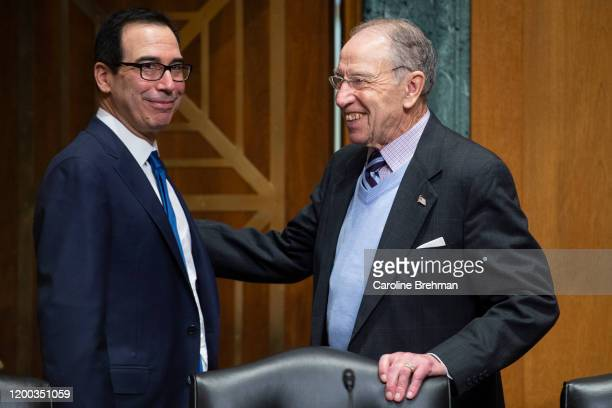 Treasury Secretary Steve Mnuchin left talks with Chairman Chuck Grassley RIowa before he testifies before the Senate Finance Committee on The...