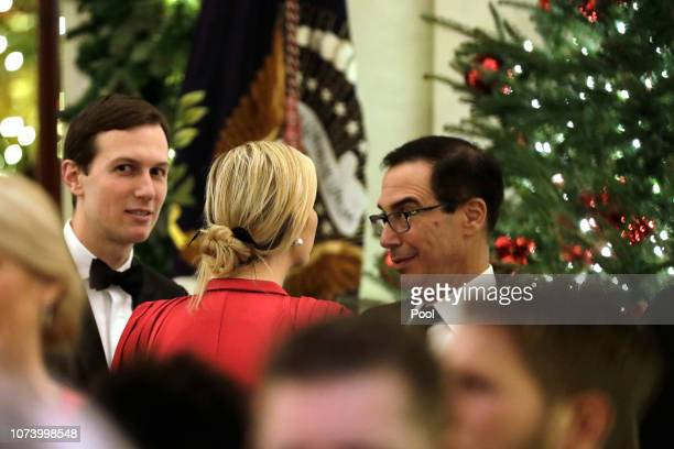S Treasury Secretary Steve Mnuchin talks to Ivanka Trump and her husband Jared Kushner at the Congressional Ball at White House in Washington on...