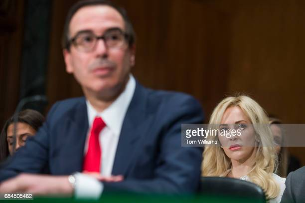 Treasury Secretary Steve Mnuchin testifies, as his fiancee Louise Linton looks on, during a Senate Banking Committee hearing in Dirksen Building...