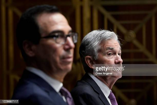 Treasury Secretary Steven Mnuchin and Federal Reserve Board Chairman Jerome Powell testify during a Senate Banking Committee hearing on Capitol Hill...