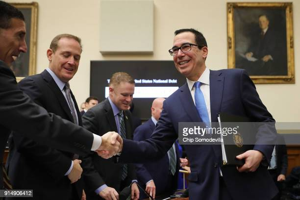 Treasury Secretary Steven Mnuchin greets members of the House Financial Services Committee before testifying on 'The Annual Report of the Financial...