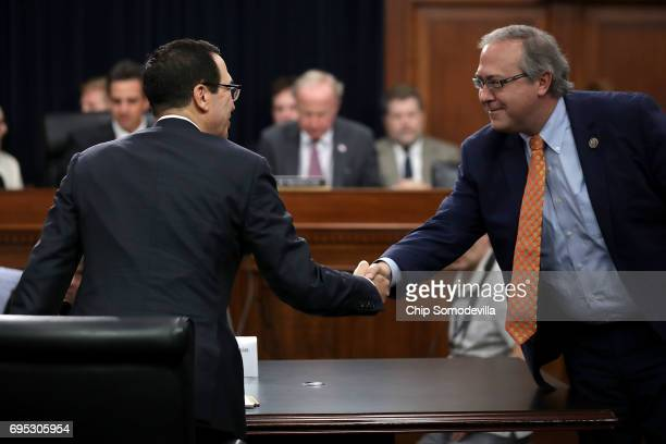 S Treasury Secretary Steven Mnuchin greets Rep David Young before a hearing of the House Appropriations Committee's Financial Services and General...